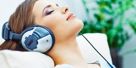 image of a patient listening to music while getting dental work
