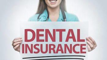 Woman holding Dental Insurance Sign