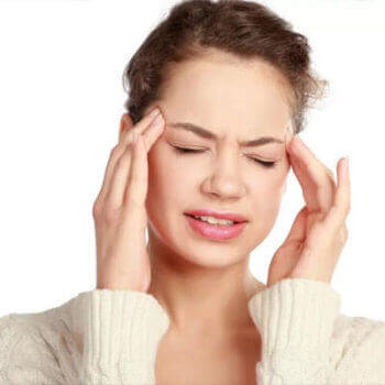 image of a patient with a headache caused by teeth grinding